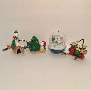 4 HALLMARK SNOOPY CHRISTMAS ORNAMENTS 1 Motion